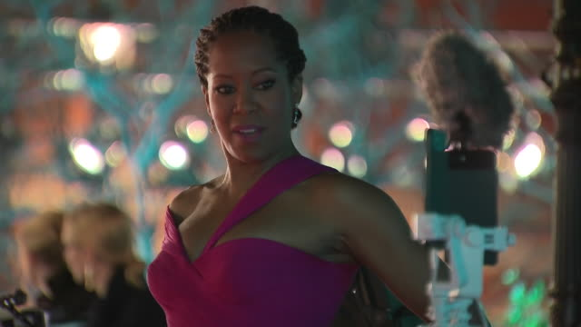 exterior shots of regina king posing for press and walking along the red carpet as she arrives for the 72nd bafta ceremony at the royal albert hall... - 英国アカデミー映画賞点の映像素材/bロール