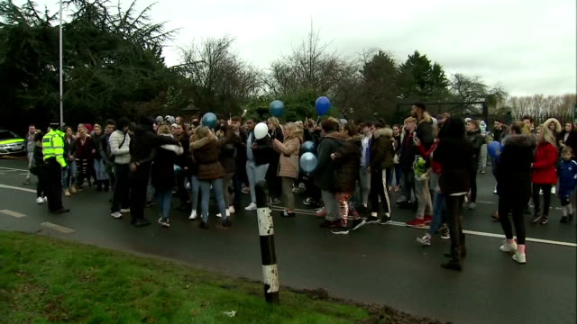 Exterior shots of relatives and friends of three teenagers who were killed when a car collided with them at a bus stop in Hayes releasing balloons...