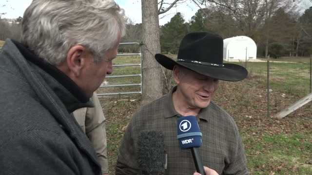 Exterior shots of Republican senator Roy Moore answering questions put to him by the media on morality and politics and his wife refuting allegations...
