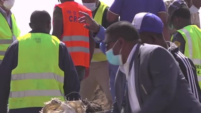 exterior shots of rescue team working at the scene of the ethiopian airlines flight et 302 plane crash on 11 march near addis ababa ethiopia - etiopia video stock e b–roll