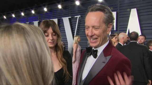 exterior shots of richard e grant interiview on the red carpet of the 2019 vanity fair oscar party on 24th february 2019 in los angeles united states - vanity fair video stock e b–roll