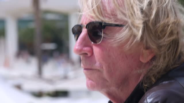 Exterior shots of Rick Parfitt co founder of Status Quo standing on waterfront looking out to port on September 14 2016 in Malaga Spain Rock...