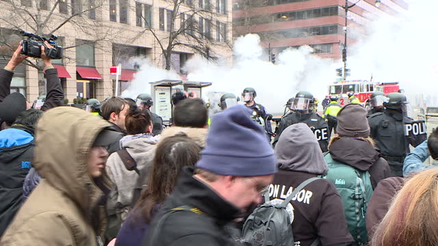 Exterior shots of riot police advancing on a crowd of anti Donald Trump protesters as tear gas rounds are fired during the Donald Trump inauguration...