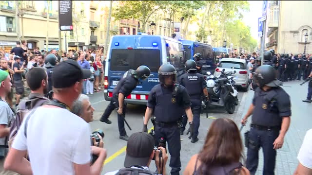 Exterior shots of riot police on the streets as counterprotesters chant antifascist slogans during a demonstration by the farright Falange group near...