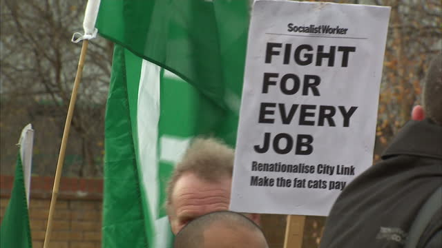 exterior shots of rmt union members on streets of coventry holding placards and signs about redundancy and city link closure on december 31 2014 in... - coventry stock videos & royalty-free footage