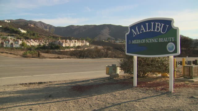 exterior shots of road sign of 'malibu 21 miles of scenic beauty' with fire brigade vehicle driving past on 13 november 2018 in malibu united states - malibu stock videos & royalty-free footage
