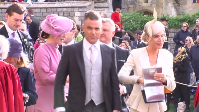 Exterior shots of Robbie Williams and wife Ayda Field arriving at St George's Chapel for the wedding of Jack Brooksbank and Princess Eugenie on 12...