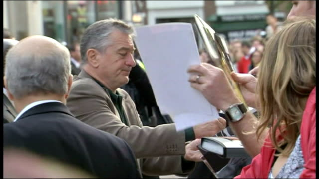 Exterior shots of Robert de Niro signing autographs for fans on the red carpet at the premiere of Righteous Kill on September 14 2008 in London...
