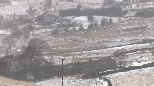 vídeos y material grabado en eventos de stock de exterior shots of rolling hills covered in snow including shots of a winding country road with surrounding snow in littleborough on 18th march 2018... - rochdale inglaterra