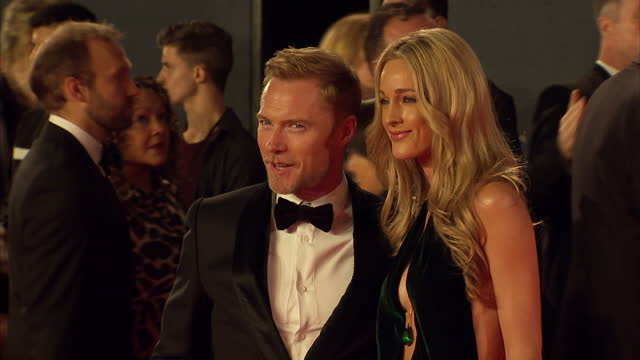 exterior shots of ronan keating and storm keating attending the royal world premiere of 'spectre' at royal albert hall on october 26 2015 in london... - ronan keating stock videos & royalty-free footage