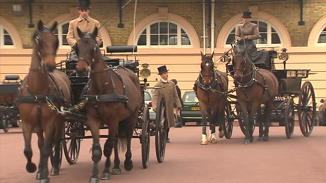 exterior shots of royal horse drawn carriages paraded through buckingham palace court preperations for the royal wedding begin at royal mews on march... - privatfahrzeug stock-videos und b-roll-filmmaterial