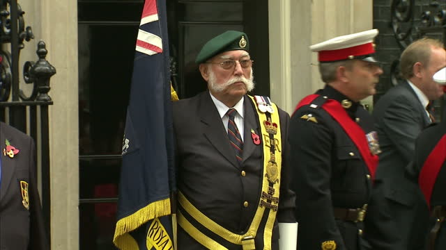 exterior shots of royal marines and veterans of the royal marines lined up outside number 10 downing street after an attempt to break the speed march... - royal marines stock videos & royalty-free footage