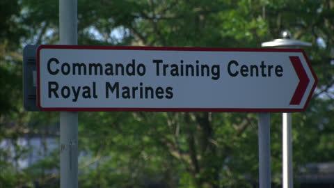 vídeos y material grabado en eventos de stock de exterior shots of royal marines commando training centre in exmouth. a royal marine has died after collapsing during the tough '30-miler' exercise on... - royal marines