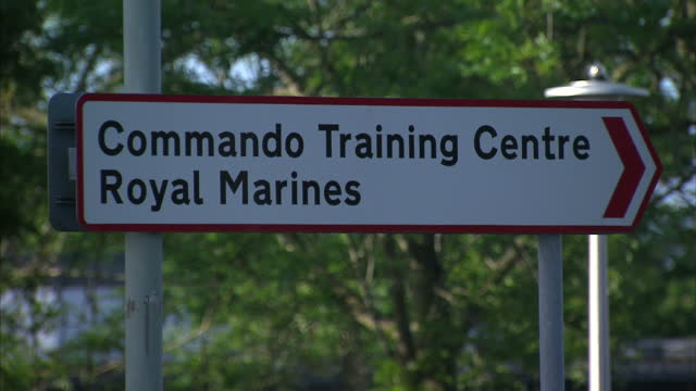 exterior shots of royal marines commando training centre in exmouth. a royal marine has died after collapsing during the tough '30-miler' exercise on... - 英国海兵隊点の映像素材/bロール