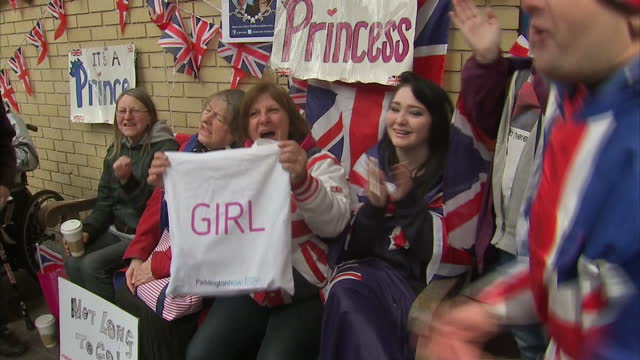 exterior shots of royalists royal fans supporters outside st mary's hospital cheering 'it's a girl' and celebrating after hearing the news of royal... - it's a girl stock videos & royalty-free footage