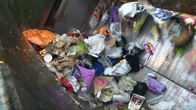 Exterior shots of rubbish in the back of a refuse lorry being crushed on January 24 2017 in London England