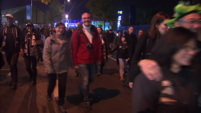 exterior shots of rugby fans new zealand and australian walking down the street at the final of the rugby world cup at twickenham stadium on october... - 2015点の映像素材/bロール