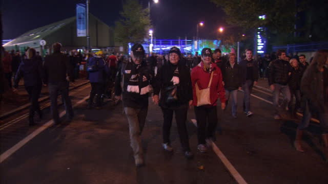 exterior shots of rugby fans new zealand and australian walking down the street at the final of the rugby world cup at twickenham stadium on october... - 2015 stock-videos und b-roll-filmmaterial