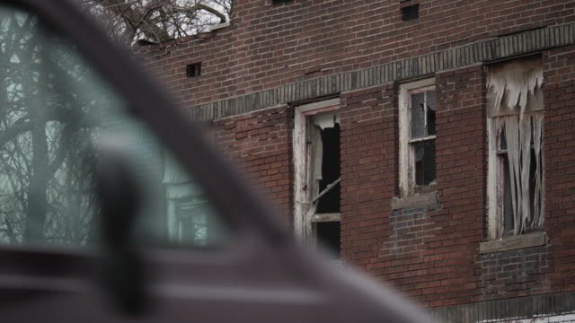 exterior shots of run down and abandoned, derelict houses in a poor neighborhood in north st louis on march 23, 2018 in st louis, missouri. - st. louis missouri stock videos & royalty-free footage