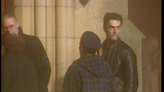 stockvideo's en b-roll-footage met exterior shots of rupert everett arriving late for madonna and guy ritchie's son rocco's christening on december 27 2000 in dornoch scotland - rupert everett