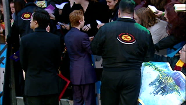 exterior shots of rupert grint signing autographs at the premiere of harry potter and the chamber of secrets on november 3 2002 in london england - potter stock videos & royalty-free footage