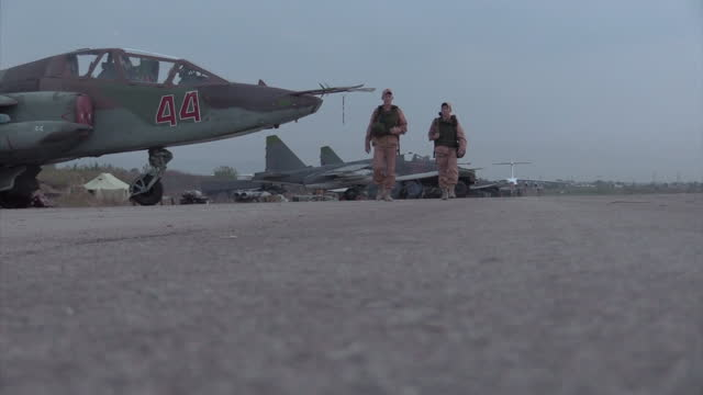 Exterior shots of Russian Air Force Sukhoi Su25 Frogfoot fighter jets on the ground at Latakia airbase on December 21 2015 in Latakia Syria