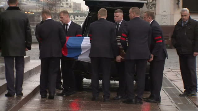 exterior shots of russian ambassador andrei karlov's coffin being taken out of hearse and carried to church on december 22 2016 in moscow russia - assassination of andrei karlov stock videos & royalty-free footage
