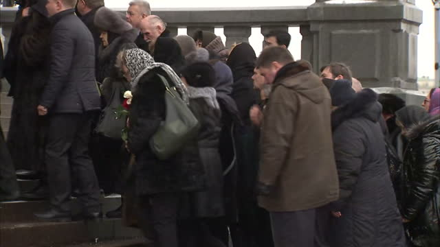 exterior shots of russian ambassador andrei karlov's coffin being carried into church followed by family including his wife marina karlova on... - assassination of andrei karlov stock videos & royalty-free footage