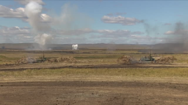 exterior shots of russian and chinese military taking part in joint military exercises on september 13 2018 in tsugol russia - militärmanöver stock-videos und b-roll-filmmaterial