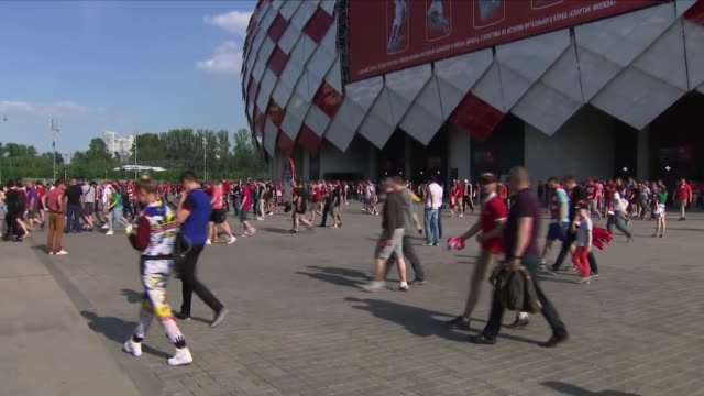Exterior shots of Russian football fans coming out of the Otkrytie Arena after a preWorld Cup friendly football match and a large military presence...