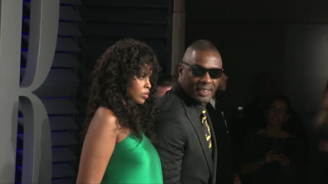 exterior shots of sabrina dhowre and idris elba posing on the red carpet of the 2019 vanity fair oscar party on 24th february 2019 in los angeles,... - oscar party stock videos & royalty-free footage