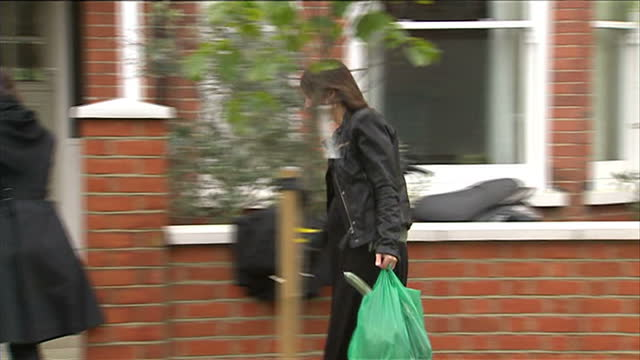 exterior shots of samantha cameron, wife of conservative leader david cameron, walking from her car into her house, which is guarded by two armed... - british liberal democratic party stock videos & royalty-free footage