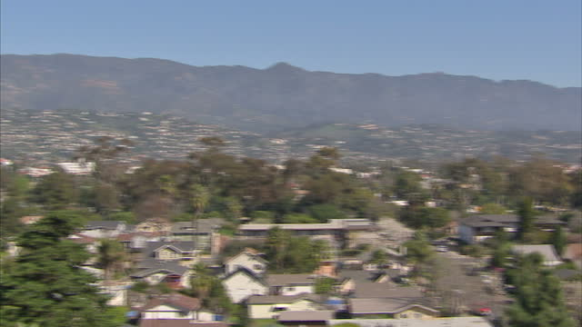 exterior shots of santa barbara residential rooftops, highway and bay area, from hilltop on february 06, 2013 in santa barbara, california. - santa barbara california stock videos & royalty-free footage