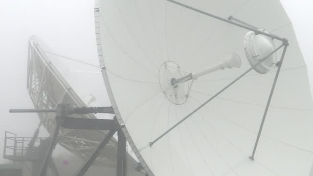 exterior shots of satellite dishes and radiocommunication site at goonhilly satellite earth station on 9th june 2021 london, united kingdom. - astronomy stock videos & royalty-free footage
