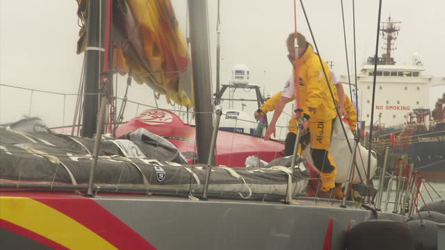 Exterior shots of SCA and Abu Dhabi yacht racing crews making preparation for Cowes Week during heavy rain>> on August 10 2014 in Various Cities...
