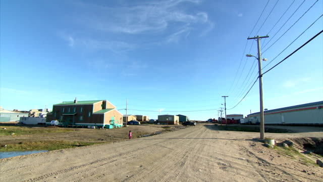 exterior shots of scenery and street scenes in pond inlet>> on august 08 2017 in pond inlet canada - inuit stock videos & royalty-free footage