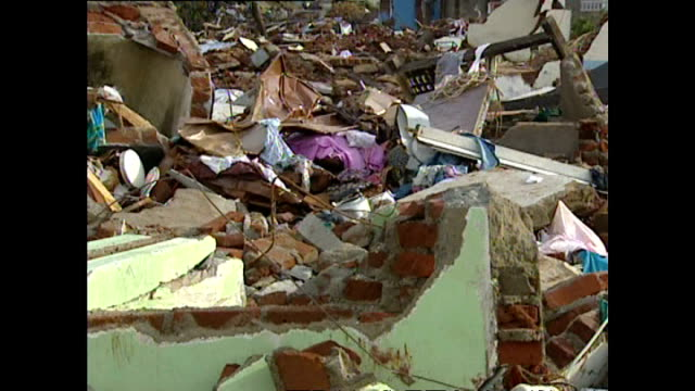 exterior shots of scenes of devastation in hambantota in the aftermath of the tsunami with demolished homes overturned vehicles and locals searching... - 2004 indian ocean earthquake and tsunami stock videos & royalty-free footage