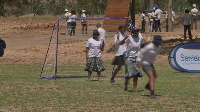exterior shots of schoolgirls playing football in a field on november 26 2015 in maseru lesotho - waisenhaus stock-videos und b-roll-filmmaterial