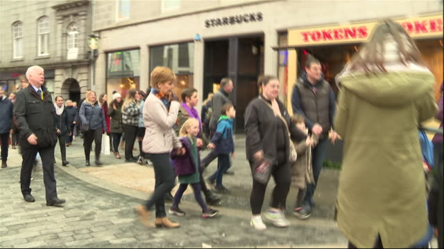 exterior shots of scottish first minister nicola sturgeon walking with young children while campaigning in the general election through a christmas... - human age stock videos & royalty-free footage