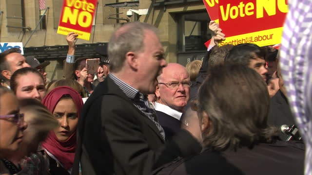 exterior shots of scottish votes campaigning, better together - no thanks votes stood outside the royal concert hall & vote yes campaigners chanting... - 2014 stock videos & royalty-free footage