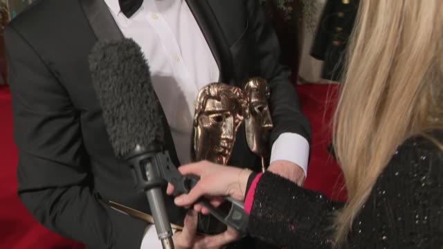 exterior shots of screenwriter tony mcnamara interview after winning on the baftas red carpet on 10th february 2019 in london, england. - scriptwriter stock videos & royalty-free footage