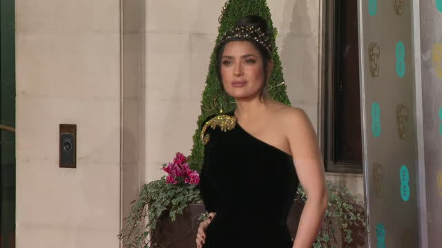 exterior shots of selma hayek on the bafta after party red carpet wearing a floorlength vneck sequined gucci gown on 10th february 2019 in london... - v neck stock videos & royalty-free footage