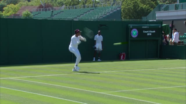 exterior shots of serena williams warming up on a practice court at wimbledon with her sister venus williams on 30 june 2018 in london, united kingdom - tennis stock videos & royalty-free footage