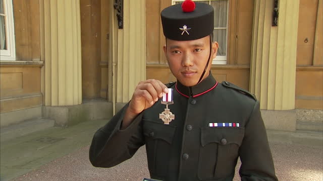 exterior shots of sergeant dipprasad pun posing in court yard of buckingham palace with conspicuous gallantry cross a gurkha who fired 400 bullets... - the conspicuous gallantry cross stock videos and b-roll footage
