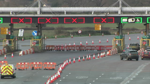 exterior shots of severn bridge toll crossing as toll booths are in the process of being dismantled. exterior shots of one of the severn bridges and... - 16 17 years stock videos & royalty-free footage