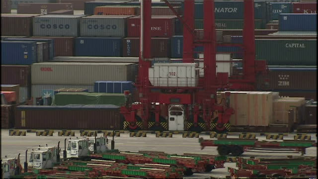 exterior shots of shipping containers being moved around by truck and crane at shanghai deep water port on october 21, 2008 in shanghai, china. - film container stock videos & royalty-free footage