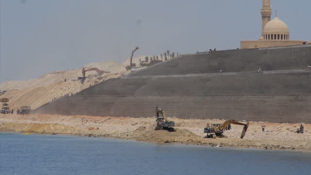 exterior shots of ships and general port activity in suez canal and construction work underway finishing off the new canal channel on august 05, 2015... - suez canal stock videos & royalty-free footage