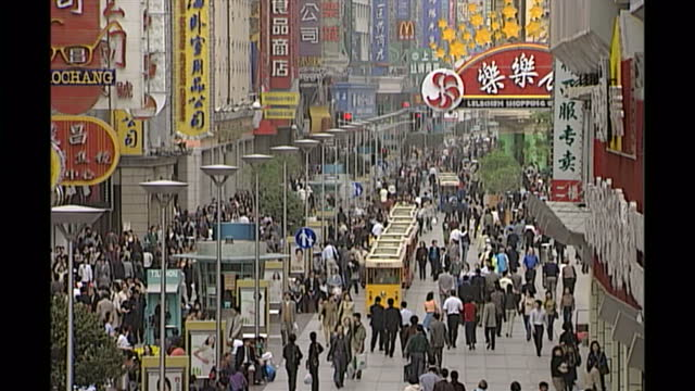 exterior shots of shoppers, a businessman smoking a cigar & people on mobile phones on april 18, 2000 in shanghai, china. - 2000s style stock videos & royalty-free footage