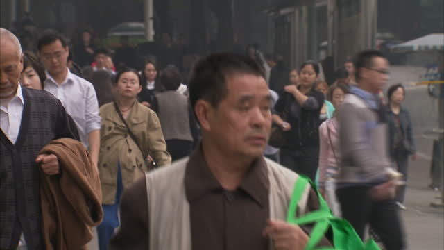 exterior shots of shoppers and commuters walking along pavement in chongqing city centre on october 17 2012 in chongqing, china. - pavement video stock e b–roll