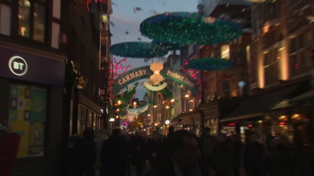 exterior shots of shoppers and tourists looking at the christmas lights on carnaby street in soho on december 06 2019 london england - shopping stock videos & royalty-free footage
